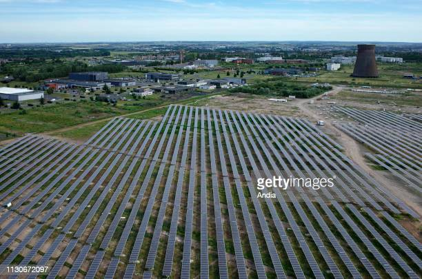 Colombelles aerial view of the biggest solar farm in a urban area in France Ferme solaire du plateau built on the industrial wasteland of the company...