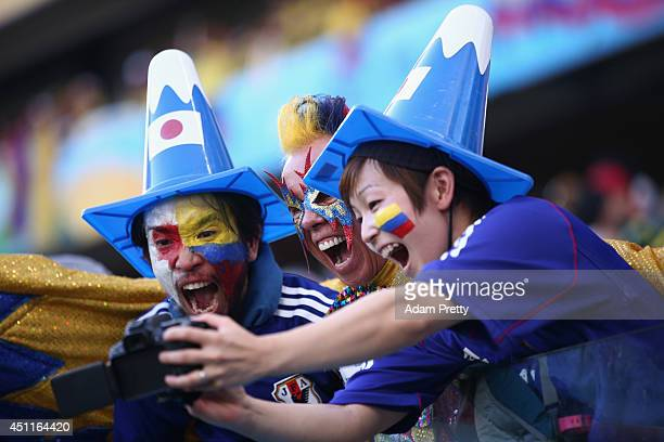 Colombia and Japan fans pose together during the 2014 FIFA World Cup Brazil Group C match between Japan and Colombia at Arena Pantanal on June 24...