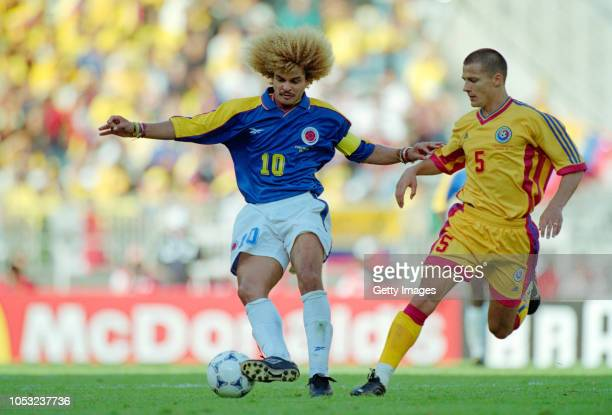 Colombia captain Carlos Valderrama holds off the challenge of Constantin Galca of Romania during the 1998 FIFA World Cup Group match between Colombia...