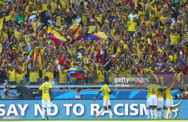 Colombia celebrate the team's third goal scored by James Rodriguez during the 2014 FIFA World Cup Brazil Group C match between Colombia and Greece at...