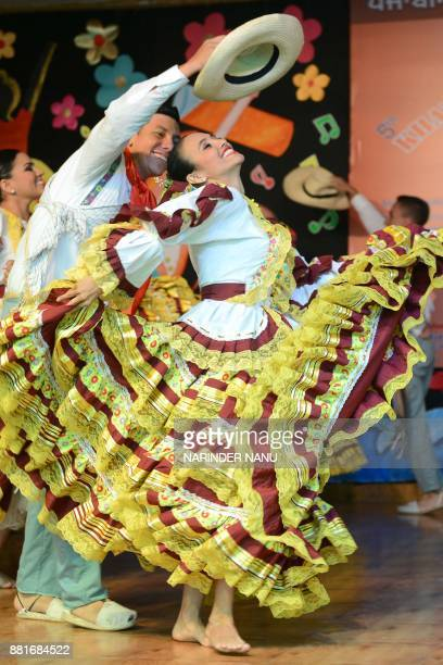 Colombia dancers perform folk dance during the fifth International Folk Festival at a school in Amritsar on November 29 2017 / AFP PHOTO / NARINDER...