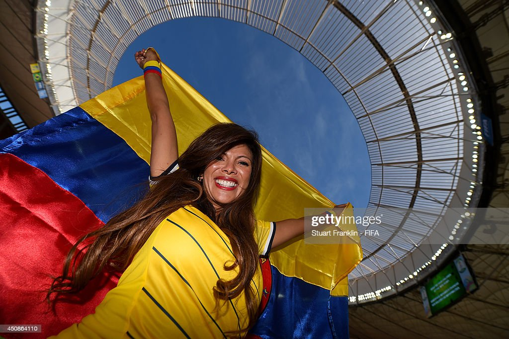 A Colombia fan poses prior to the 2014 FIFA World Cup Brazil Group C match between Colombia and Cote D'Ivoire at Estadio Nacional on June 19, 2014 in Brasilia, Brazil.
