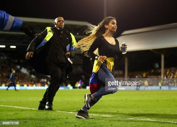 Colombia fan runs away from a steward during the International friendly between Australia and Colombia at Craven Cottage on March 27 2018 in London...