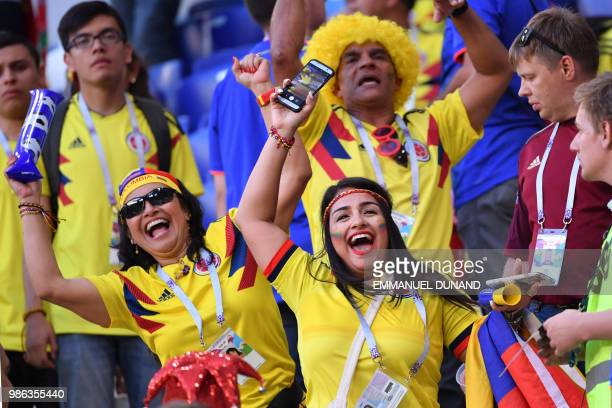 TOPSHOT Colombia fans celebrate at the end of the Russia 2018 World Cup Group H football match between Senegal and Colombia at the Samara Arena in...