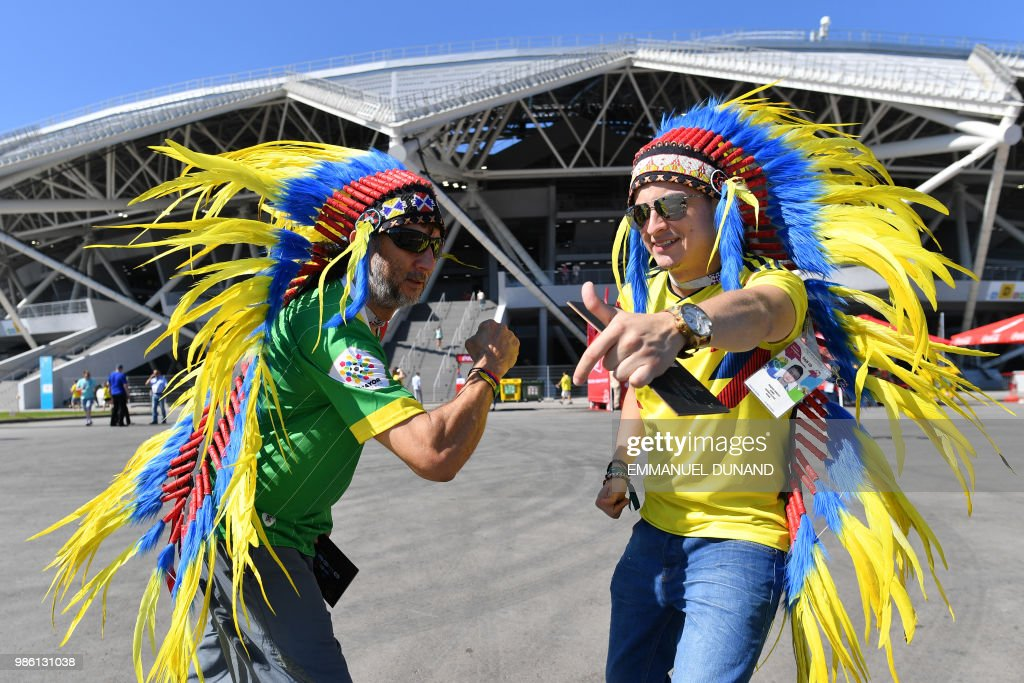 Colombia fans gesture before the Russia 2018 World Cup Group H football match between Senegal and Colombia at the Samara Arena in Samara on June 28, 2018. (Photo by EMMANUEL DUNAND / AFP) / RESTRICTED