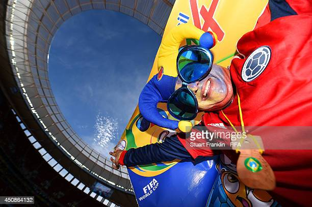 Colombia fans pose prior to the 2014 FIFA World Cup Brazil Group C match between Colombia and Cote D'Ivoire at Estadio Nacional on June 19 2014 in...