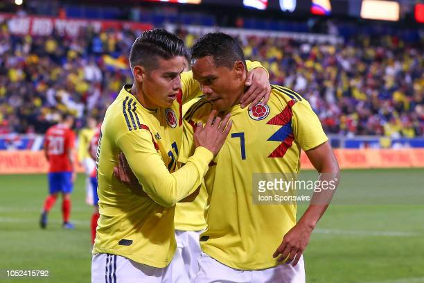 Colombia forward Carlos Bacca celebrates with Colombia midfielder James Rodriguez after scoring during the first half of the International Friendly...