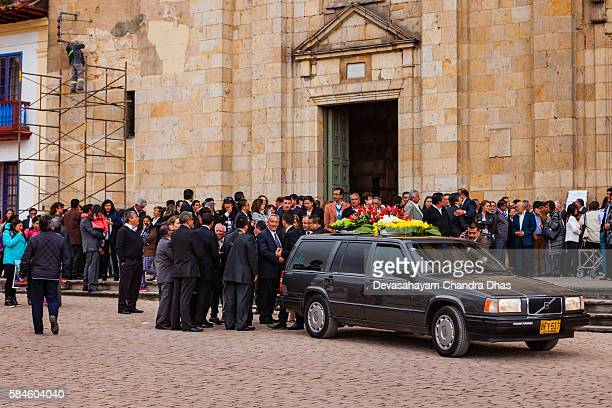 colombia: funeral mass just concluded,  zipaquira church on the plaza - hearse stock pictures, royalty-free photos & images