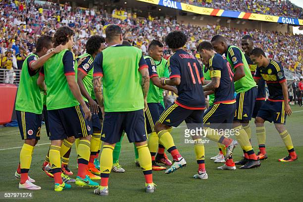 Colombia players celebrate a goal by James Rodriguez of Colombia on a penalty kick during a group A match between United States and Colombia at...