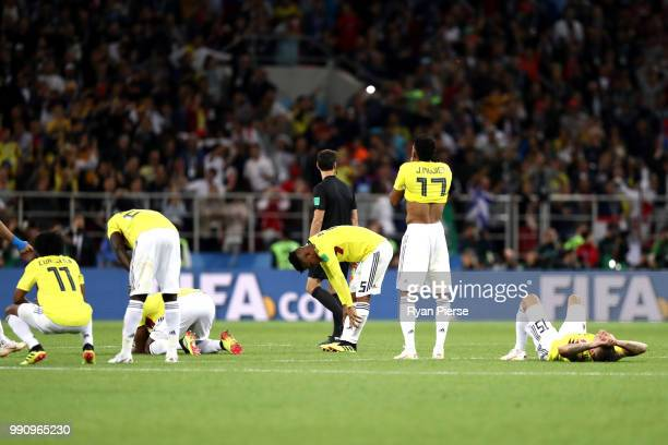 Colombia players look dejected following their sides defeat in a penalty shoot out during the 2018 FIFA World Cup Russia Round of 16 match between...