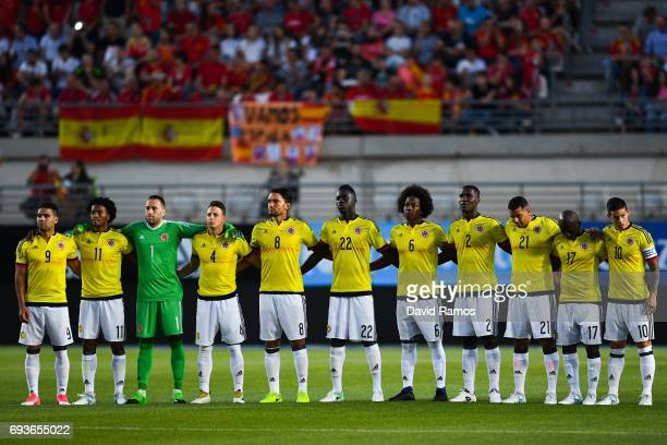 Colombia players observe a minute of silence during a friendly match between Spain and Colombia at La Nueva Condomina stadium on June 7 2017 in...
