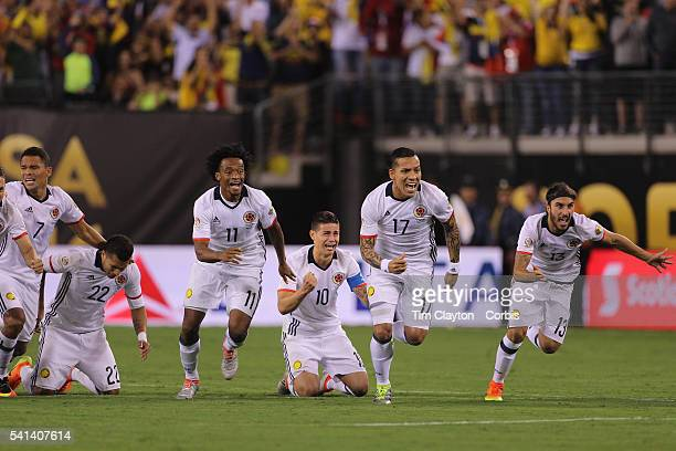 Colombia players react to David Ospina of Colombia final save to win the penalty shoot out players include Juan Cuadrado James Rodriguez Dayro Moreno...