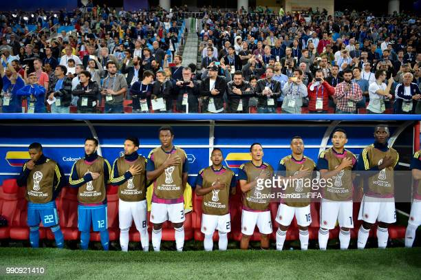 Colombia players sing the national anthem from the bench during the 2018 FIFA World Cup Russia Round of 16 match between Colombia and England at...