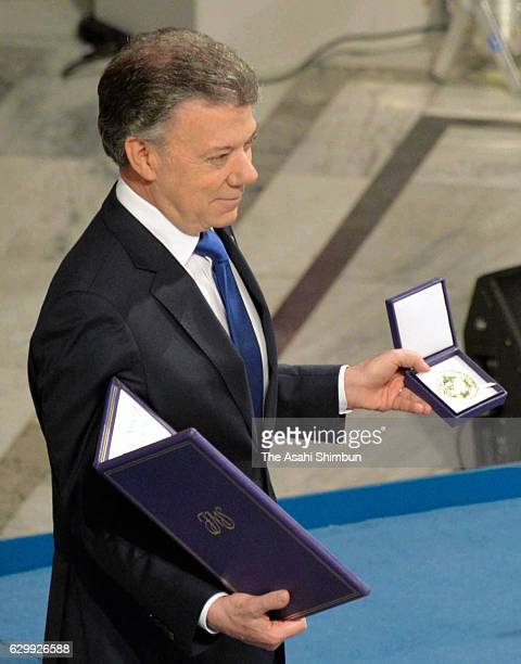 Colombia President Juan Manuel Santos receives his certificate and medal during the Nobel Peace Prize ceremony at Oslo Town Hall on December 10 2016...