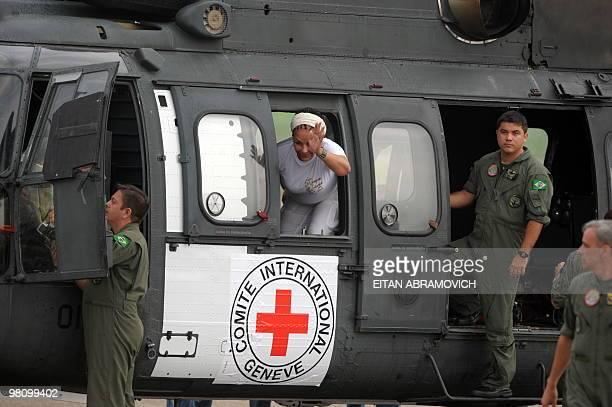 Colombia senator and humanitarian delegation member Piedad Cordoba waves aboard a Brazilian helicopter at the start of the airborne operation to pick...
