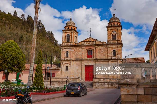 colombia, south america - the church on the main plaza in the town of nemocón in the cundinamarca department. afternoon sunlight. - cundinamarca stock pictures, royalty-free photos & images