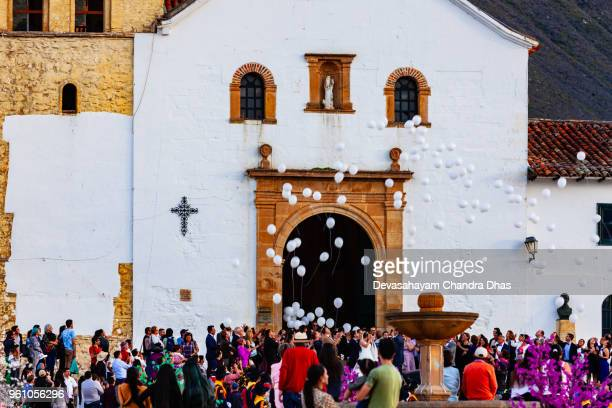 colombia, south america - wedding at the church on the plaza mayor of the historic 16th century town of villa de leyva; white balloons released in celebration - church wedding decorations stock pictures, royalty-free photos & images