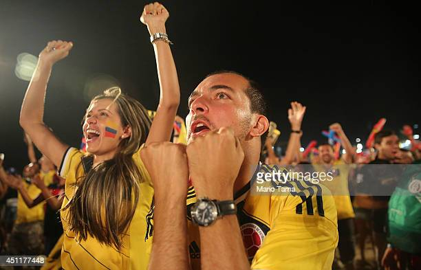 Colombia supporters celebrate after they defeated Japan while watching at the FIFA Fan Fest on Copacabana Beach on June 24 2014 in Rio de Janeiro...