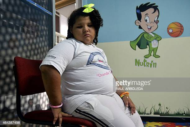 Colombian 8year old Dana Garcia waits for a medical checkup in Medellin Antioquia department Colombia on February 25 after she was rescued by members...