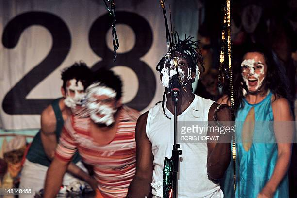 Colombian actor Julian Diaz and actors of the Mapa Teatro from Bogota perform during a rehearsal of the play Los Santos Inocentes first part of a...