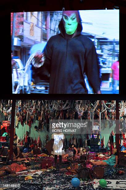 Colombian actor Julian Diaz performs with Mapa Teatro actors from Bogota during a rehearsal of the play Los Santos Inocentes first part of a tryptic...