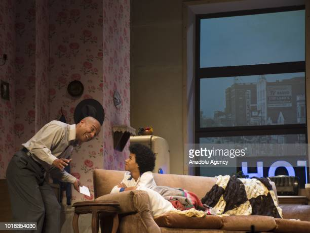 Colombian actors perform at the stage of the Colon Theater during a Broadway classic play 'A raisin in the sun' on August 17 2018 in Bogota Colombia