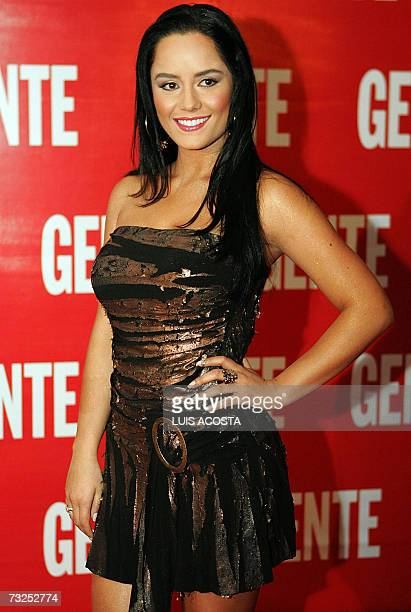 Colombian actress Ana Lucia Dominguez poses for photographers on the red carpet during the presentation by the magazine 'Gente' in Mexico City 07...