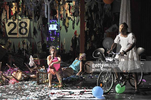 Colombian actress Heidi Abderhalden and actors of the Mapa Teatro from Bogota perform during a rehearsal of the play Los Santos Inocentes first part...
