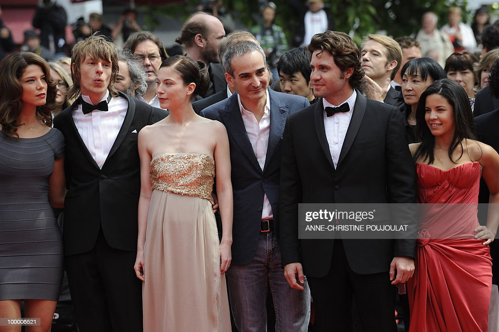 Colombian actress Juana Acosta (L), French director Olivier Assayas (C) and Venezuelian born actor Edgar Ramirez (2ndR) arrive with the cast for the screening of 'Carlos' presented out of competition at the 63rd Cannes Film Festival on May 19, 2010 in Cannes.
