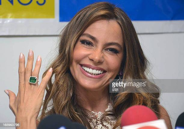Colombian actress Sofia Vergara shows a ring with a Colombian emerald during a press conference in Barranquilla Colombia on April 7 2013 Vergara is...