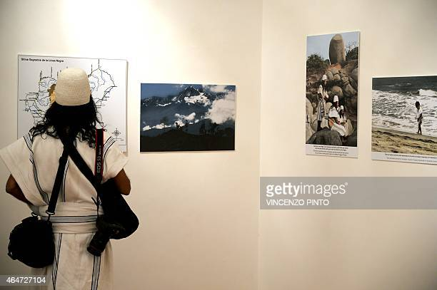 Colombian Amado Villafana an Arawak people looks at pictures in Rome on February 26 2015 Villafana a photographer and spiritual leader of his tribe...