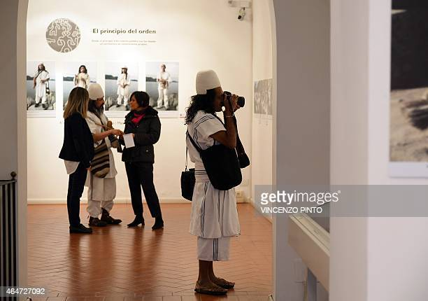 Colombian Amado Villafana an Arawak people takes pictures in Rome on February 26 2015 Villafana a photographer and spiritual leader of his tribe is...