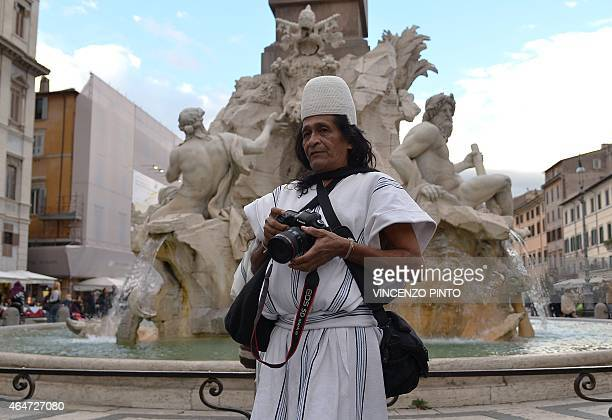 Colombian Amado Villafana an Arawak people walks in Navona Square in Rome on February 26 2015 Villafana a photographer and spiritual leader of his...