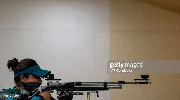 Colombian Angela Rodriguez competes in the Women's 10m Air Rifle Shooting Final at the XVIII Juegos Bolivarianos in Cali Colombia on November 13 2017...
