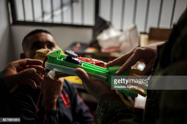 Colombian Armed Forces member injured by a mine learns how to put together Arm prosthesis at Foundation of Materialization 3D in Bogota Colombia...