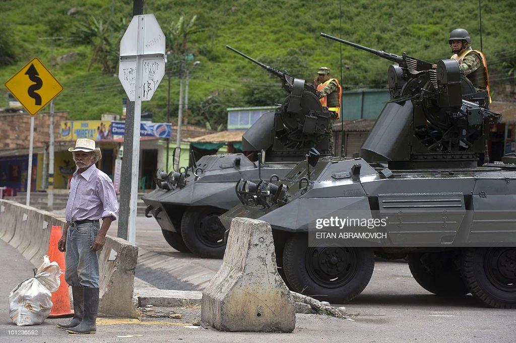 A Colombian army armored cars stay in position along a road on the way from Bogota to Villavicencio on May 28, 2010. Colombia will hold presidential elections next May 30. AFP PHOTO/Eitan Abramovich