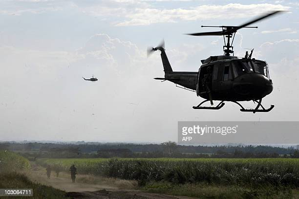 A Colombian army UH1H Huey II helicopter lands at a military base in Miranda department of Cauca Colombia on July 23 2010 AFP PHOTO/Luis ROBAYO