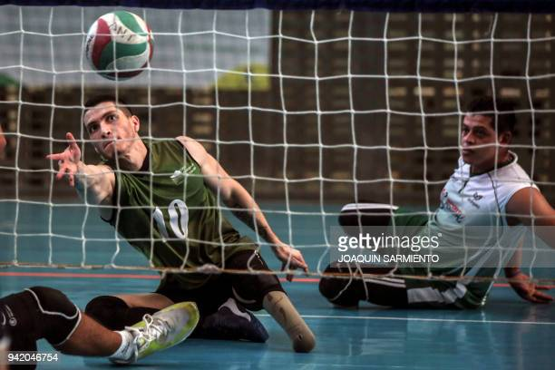 TOPSHOT Colombian Army veteran and victim of a land mine Didier Montoya takes part in a practice session with Antioquia's Sitting Volleyball Team on...