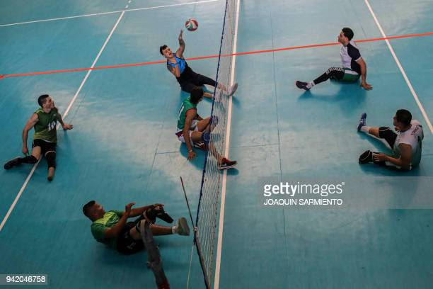 TOPSHOT Colombian Army veterans victims of land mines take part in a practice session with Antioquia's Sitting Volleyball Team on April 4 2018 in...