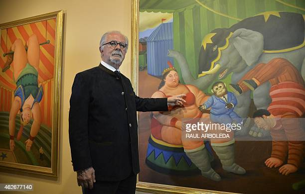 Colombian artist Fernando Botero poses next to a painting of the collection called The Circus during the opening at the Antioquia museum in Medellin...