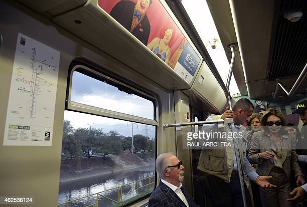 Colombian artist Fernando Botero rests next to his wife Sophia Vari next to a painting of the collection called 'The Circus' at a train's wagon in...