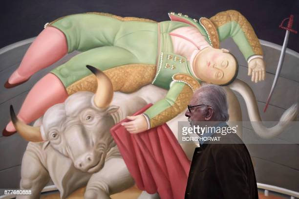 Colombian artist Fernando Botero walks on November 22 past one of his painting displayed at the Hotel de Caumont in Aix en Provence southern France...