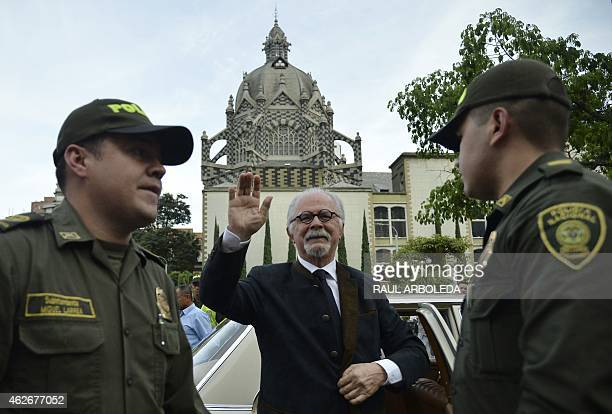 Colombian artist Fernando Botero weaves to suporters during the opening of his exhibition called The Circus at the Antioquia museum in Medellin...