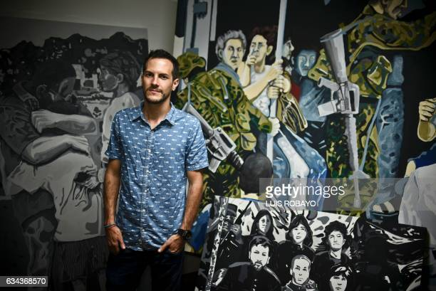 Colombian artist Juan Daniel Otoya poses beside his work in Cali department of Valle del Cauca Colombia on January 12 2017 Otoya was abducted by the...