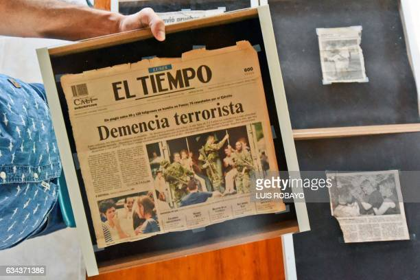 Colombian artist Juan Daniel Otoya shows newspaper clippings from his 1999 kidnapping by the National Liberation Army guerrillas with photographs...