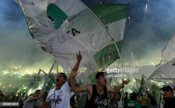 TOPSHOT Colombian Atletico Nacional supporters cheer for their team before the start of the Libertadores Cup final match against Ecuadorean...