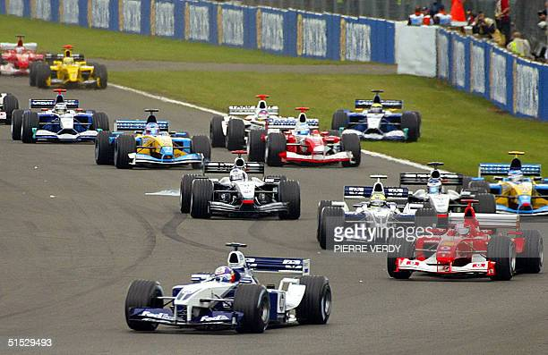 Colombian BMWWilliams driver Juan Pablo Montoya leads the pack ahead of German Ferrari driver Michael Schumacher and German BMWWilliams driver Ralf...