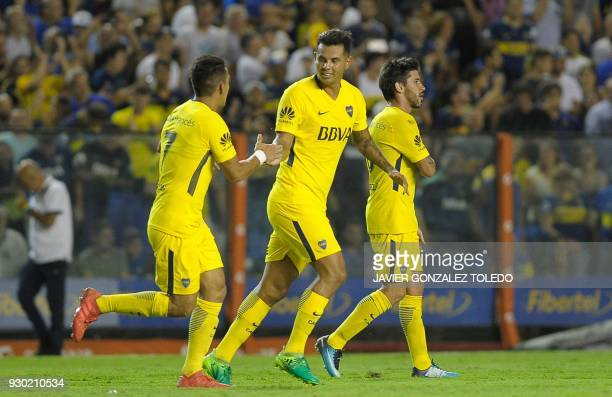 Colombian Boca Juniors' midfielder Edwin Cardona celebrates after scoring against Tigre during their Argentina First Division Superliga football...