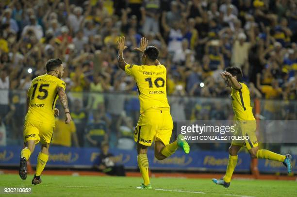 Colombian Boca Juniors' midfielder Edwin Cardona celebrates with teammates after scoring against Tigre during their Argentina First Division...