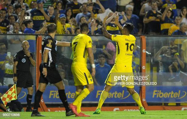 Colombian Boca Juniors' midfielder Edwin Cardona gestures at the crowd as he celebrates scoring against Tigre during their Argentina First Division...